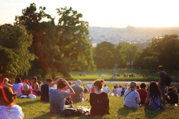 Group of people in a crowd in an urban green space:park